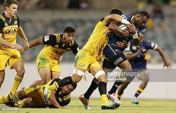 Tevita Kuridrani of the Brumbies is tackled by Ardie Savea of the Hurricanes during the round one Super Rugby match between the Brumbies and the...