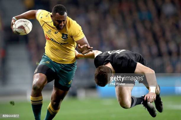 Tevita Kuridrani of the Wallabies is tackled by Beauden Barrett of the All Blacks during The Rugby Championship Bledisloe Cup match between the New...