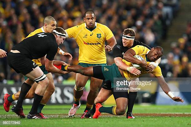 Tevita Kuridrani of the Wallabies is tackled by the All Blacks defence during the Bledisloe Cup Rugby Championship match between the Australian...