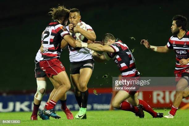 Tevita Li of North Harbour is tackled by Orbyn Leger of Counties and Stephen Donald of Counties during the round four Mitre 10 Cup match between...