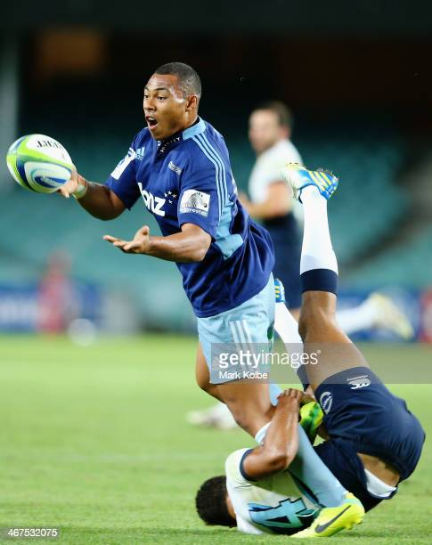Tevita Li of the Blues gets a pass away as he is tackled tackled during the Super Rugby trial match between the Waratahs and the Blues at Allianz...
