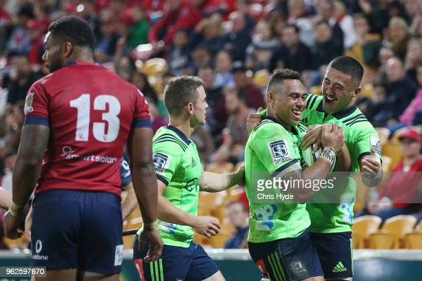 Tevita Li of the Highlanders celebrates a try during the round 15 Super Rugby match between the Reds and the Highlanders at Suncorp Stadium on May 26...