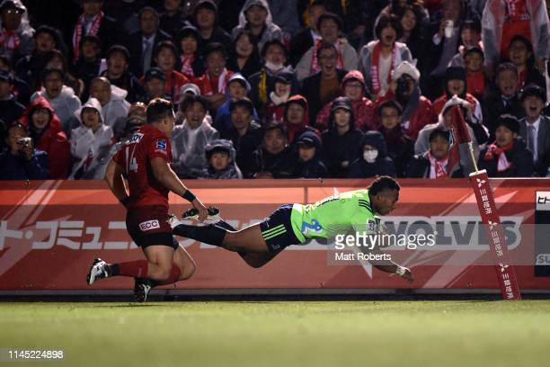 Tevita Li of the Highlanders dives to score his side's sixth try during the round 11 Super Rugby match between Sunwolves and Highlanders at the...