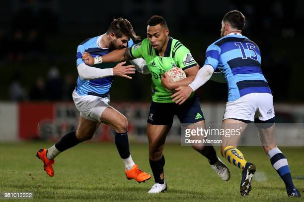 Tevita Li of the Highlanders fends off Hugo Bonneval during the match between the Highlanders and the French Barbarians at Rugby Park Stadium on June...