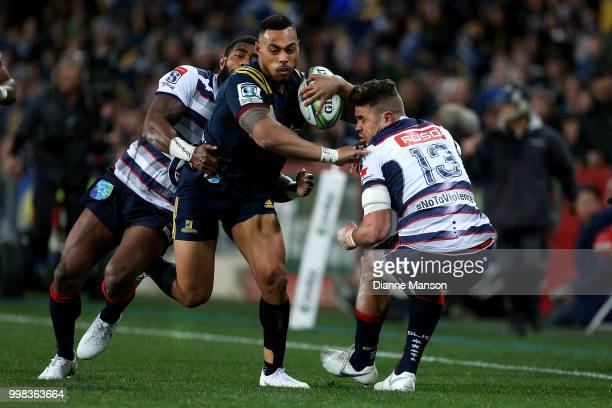 Tevita Li of the Highlanders fends off Tom English of the Rebels during the round 19 Super Rugby match between the Highlanders and the Rebels at...