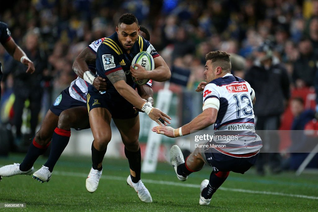 Tevita Li of the Highlanders fends off Tom English of the Rebels during the round 19 Super Rugby match between the Highlanders and the Rebels at Forsyth Barr Stadium on July 14, 2018 in Dunedin, New Zealand.