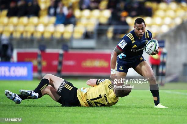 Tevita Li of the Highlanders is tackled by Jordie Barrett of the Hurricanes during the round 4 Super Rugby match between the Wellington Hurricanes...