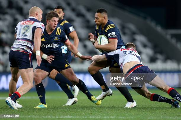 Tevita Li of the Highlanders is tackled by Reece Hodge of the Rebels during the round 19 Super Rugby match between the Highlanders and the Rebels at...