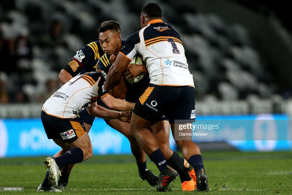 Tevita Li of the Highlanders is tackled by Scott Sio of the Brumbies during the round nine Super Rugby match between the Highlanders and the Brumbies at Forsyth Barr Stadium on April 14, 2018 in Dunedin, New Zealand.
