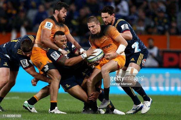 Tevita Li of the Highlanders is tackled by Sebastian Cancelliere of the Jaguares during the round 13 Super Rugby match between the Highlanders and...