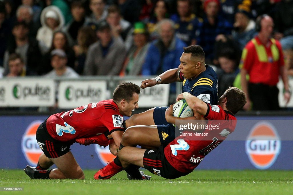 Tevita Li of the Highlanders is tackled by Tim Bateman (L) and Mitchell Hunt of the Crusaders during the round five Super Rugby match between the Highlanders and the Crusaders at Forsyth Barr Stadium on March 17, 2018 in Dunedin, New Zealand.