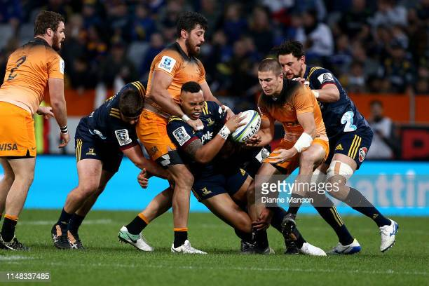Tevita Li of the Highlanders is tackled during the round 13 Super Rugby match between the Highlanders and the Jaguares at Forsyth Barr Stadium on May...