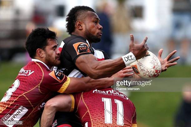 Tevita Nabura of Counties Manukau is tackled by Matt Johnson and Jackson Ormond of Southland during the round four Mitre 10 Cup match between...