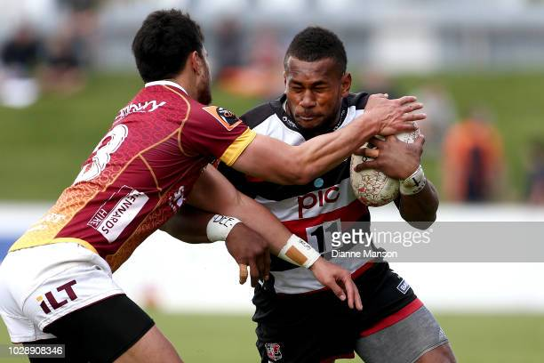 Tevita Nabura of Counties Manukau is tackled by Matt Johnson of Southland during the round four Mitre 10 Cup match between Southland and Counties...