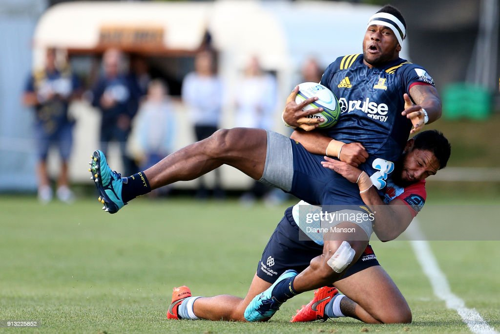 Tevita Nabura of the Highlanders is tackled by Curtis Rona of the Waratahs during the Super Rugby pre-season match between the Highlanders and the Waratahs on February 2, 2018 in Queenstown, New Zealand.