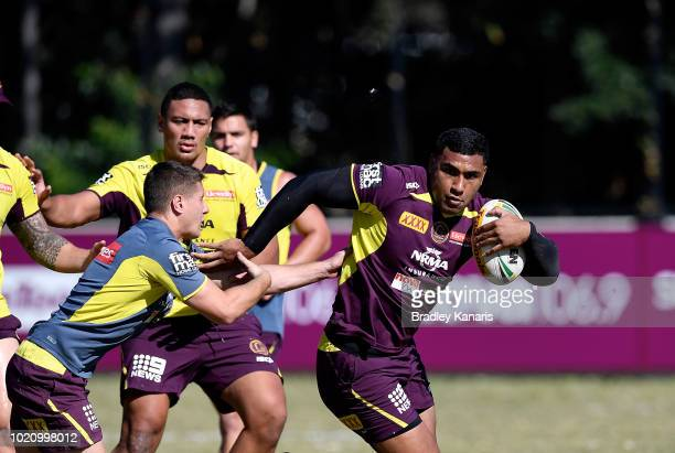 Tevita Pangai breaks through the defence during a Brisbane Broncos NRL training session on August 22 2018 in Brisbane Australia