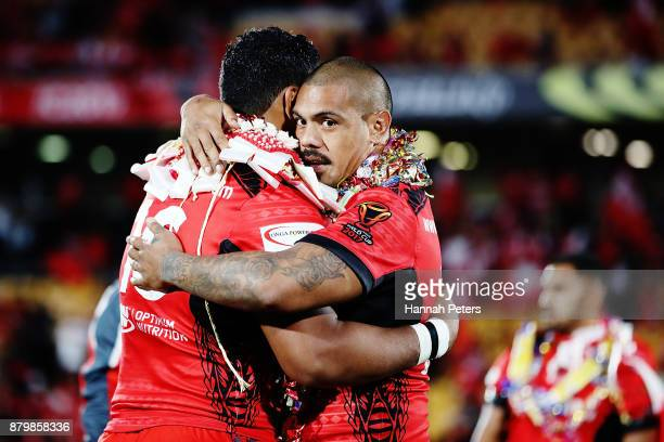Tevita Pangai Junior embraces Sika Manu of Tonga after losing the 2017 Rugby League World Cup Semi Final match between Tonga and England at Mt Smart...