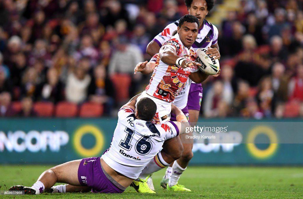 Tevita Pangai Junior of the Broncos attempts to break away from the defence during the round 17 NRL match between the Brisbane Broncos and the Melbourne Storm at Suncorp Stadium on June 30, 2017 in Brisbane, Australia.