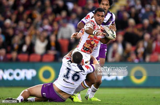 Tevita Pangai Junior of the Broncos attempts to break away from the defence during the round 17 NRL match between the Brisbane Broncos and the...