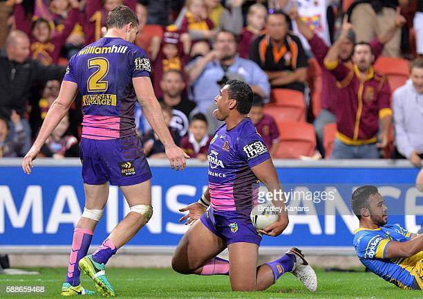 Tevita Pangai Junior of the Broncos celebrates scoring a try during the round 23 NRL match between the Brisbane Broncos and the Parramatta Eels at...