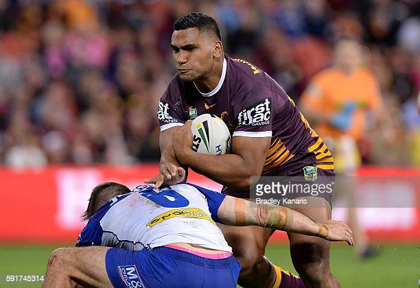 Tevita Pangai Junior of the Broncos charges into the defence during the round 24 NRL match between the Brisbane Broncos and the Canterbury Bulldogs...