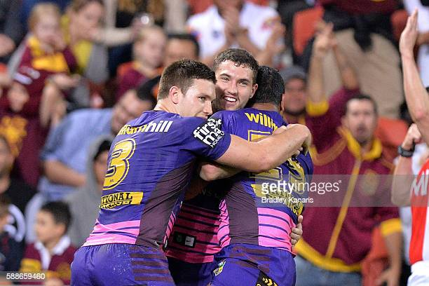 Tevita Pangai Junior of the Broncos is congratulated by team mates after scoring a try during the round 23 NRL match between the Brisbane Broncos and...