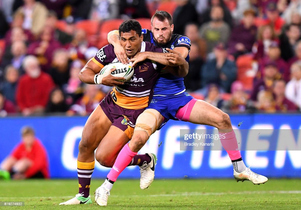 Tevita Pangai Junior of the Broncos is tackled by Josh Reynolds of the Bulldogs during the round 20 NRL match between the Brisbane Broncos and the Canterbury Bulldogs at Suncorp Stadium on July 20, 2017 in Brisbane, Australia.