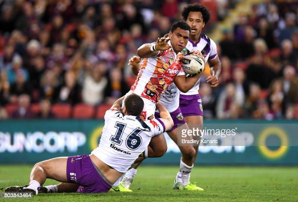 Tevita Pangai Junior of the Broncos is tackled during the round 17 NRL match between the Brisbane Broncos and the Melbourne Storm at Suncorp Stadium...