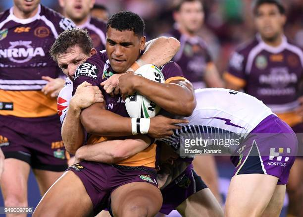 Tevita Pangai Junior of the Broncos is tackled during the round seven NRL match between the Brisbane Broncos and the Melbourne Storm at Suncorp...