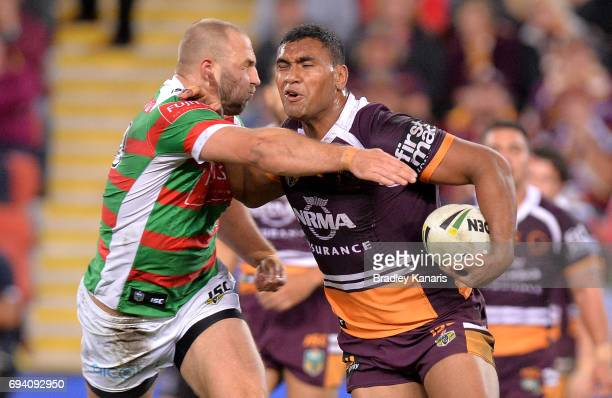 Tevita Pangai Junior of the Broncos takes on the defence during the round 14 NRL match between the Brisbane Broncos and the South Sydney Rabbitohs at...