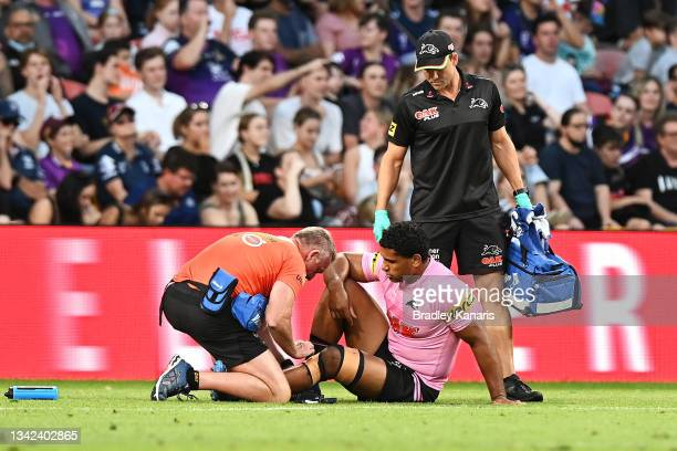 Tevita Pangai Junior of the Panthers receives attention from the trainer during the NRL Preliminary Final match between the Melbourne Storm and the...