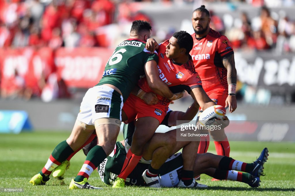 Tevita Pangai Junior of Tonga offloads the ball during the 2017 Rugby League World Cup Quarter Final match between Tonga and Lebanon at AMI Stadium on November 18, 2017 in Christchurch, New Zealand.