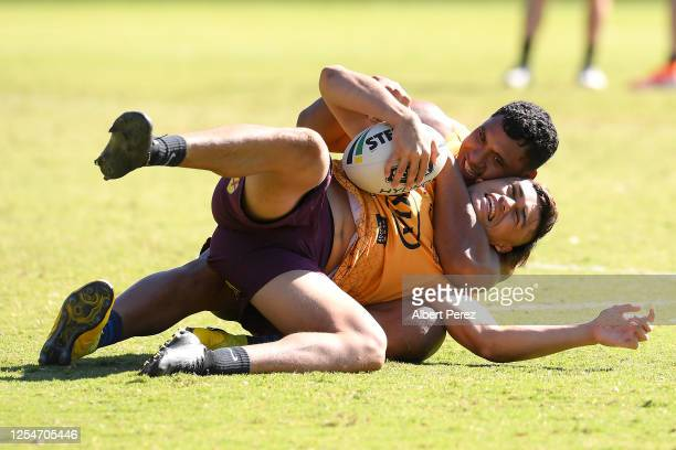 Tevita Pangai Junior tackles Richard Kennar during a Brisbane Broncos NRL training session at the Clive Berghofer Centre on July 07 2020 in Brisbane...