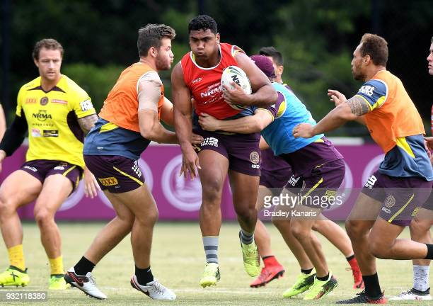 Tevita Pangai Junior takes on the defence during the Brisbane Broncos NRL training session on March 15 2018 in Brisbane Australia