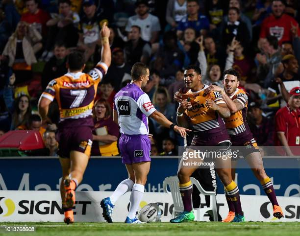 Tevita Pangai of the Broncos celebrates after scoring a try during the round 22 NRL match between the North Queensland Cowboys and the Brisbane...