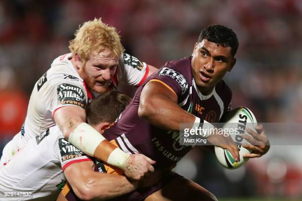 Tevita Pangai of the Broncos is tackled by James Graham of the Dragons during the round one NRL match between the St George Illawarra Dragons and the...