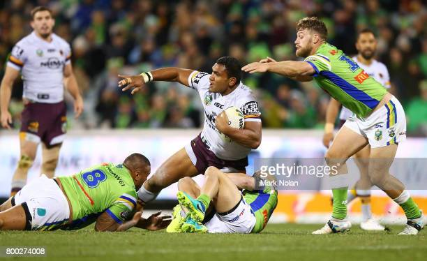 Tevita Pangai of the Broncos is tackled during the round 16 NRL match between the Canberra Raiders and the Brisbane Broncos at GIO Stadium on June 24...
