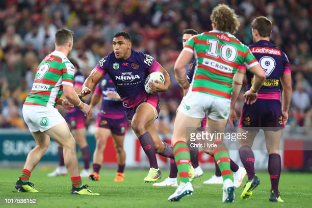 Tevita Pangai of the Broncos is tackled during the round 23 NRL match between the Brisbane Broncos and the South Sydney Rabbitohs at Suncorp Stadium...