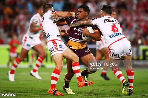 Tevita Pangai of the Broncos is tackled during the round one NRL match between the St George Illawarra Dragons and the Brisbane Broncos at UOW...