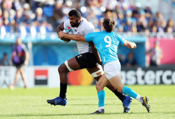 KAMAISHI, JAPAN - SEPTEMBER 25: Tevita Ratuva runs past Santiago Arata of Uruguay during the Rugby World Cup 2019 Group D game between Fiji and Uruguay at Kamaishi Recovery Memorial Stadium on September 25, 2019 in Kamaishi, Iwate, Japan. (Photo by Warren Little - World Rugby/World Rugby via Getty Images)