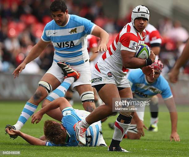Tevita Tatafu of Japan makes a break during the World Rugby U20 Championship match between Argentina and Japan at AJ Bell Stadium on June 15 2016 in...