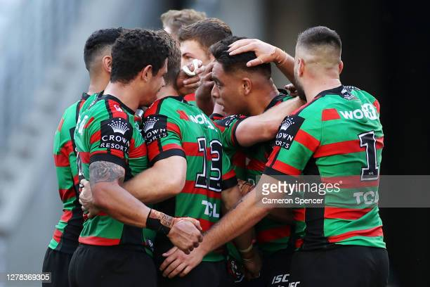 Tevita Tatola of the Rabbitohs celebrates scoring a try with team mates during the NRL Elimination Final match between the South Sydney Rabbitohs and...