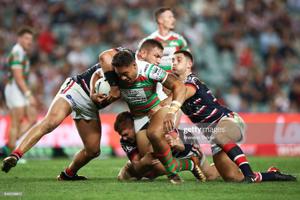Tevita Tatola of the Rabbitohs is tackled by Roosters defence during the round six NRL match between the Sydney Roosters and the South Sydney Rabbitohs at Allianz Stadium on April 12, 2018 in Sydney, Australia.