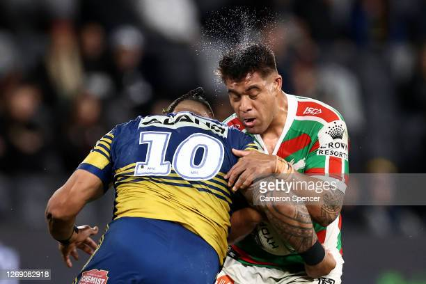 Tevita Tatola of the Rabbitohs is tackled during the round 16 NRL match between the Parramatta Eels and the South Sydney Rabbitohs at Bankwest...