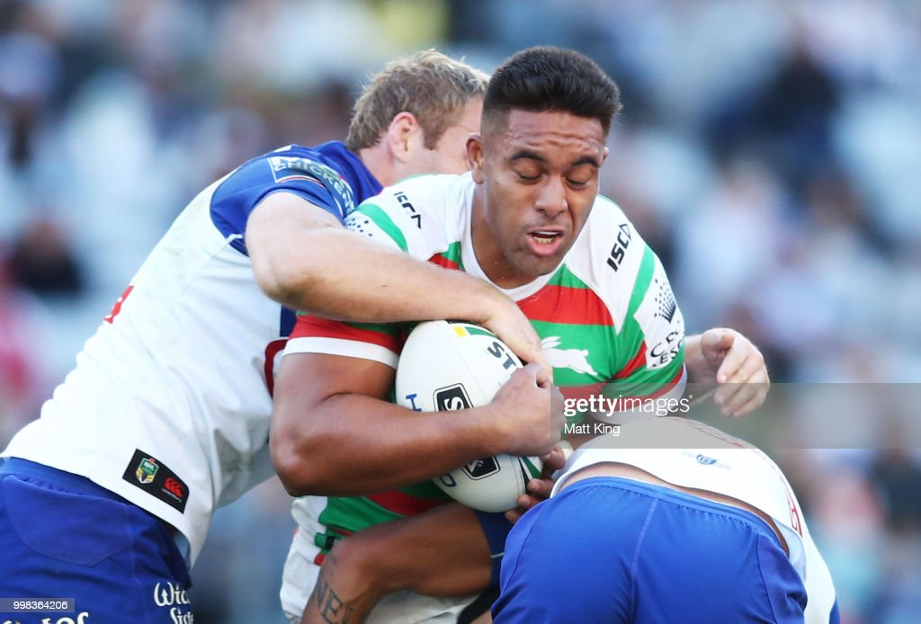 Tevita Tatola of the Rabbitohs is tackled during the round 18 NRL match between the Canterbury Bulldogs and the South Sydney Rabbitohs at ANZ Stadium on July 14, 2018 in Sydney, Australia.