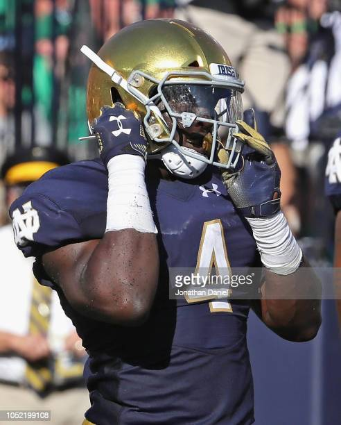 Te'von Coney of the Notre Dame Fighting Irish adjusts his helmet during a game against the Vanderbilt Commodores at Notre Dame Stadium on September...