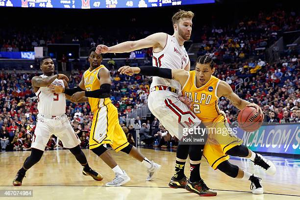 Tevonn Walker of the Valparaiso Crusaders drives against Evan Smotrycz of the Maryland Terrapins during the second round of the Men's NCAA Basketball...