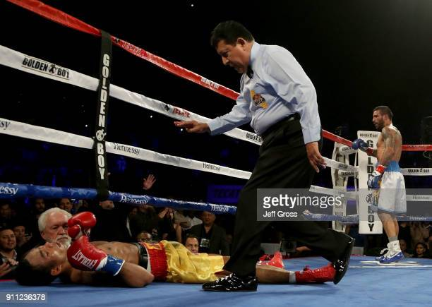 Tewa Kiram of Thailand receives a standing eight count after being knocked down by Lucas Matthysse of Argentina during their bout at The Forum on...