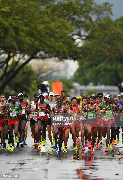 Tewelde Estifanos of Eritrea leads the pack during the Men's Marathon on Day 16 of the Rio 2016 Olympic Games at Sambodromo on August 21 2016 in Rio...