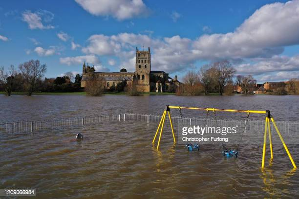 Tewkesbury Abbey and a children's playground at the confluence of the Rivers Severn and Avon is surrounded by flood waters on February 27 2020 in...